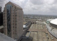 Aerial view of Benson Tower with parking and the Superdome to the right.