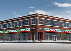 A rendering of the MOLO Village building, with a red brick two-story building with white accents and bright green and red awnings over the first floor retail windows.